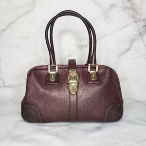 Gucci leather horsebit embossed purse